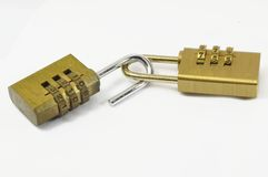 Combination locks. Brass yellow gold combination lock on a white background Stock Images