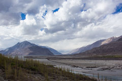 The combination of nature. The combination of nature : trees, river, rocky mountain, snow mountain and desert. Leh Ladakh Royalty Free Stock Image