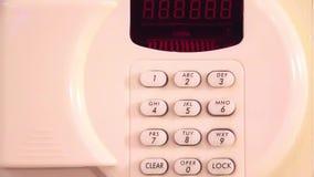 Combination numeric lock on safe stock footage