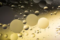 Mixing water and oil, beautiful color abstract background based on circles and ovals. A combination of oil and water, a fantastic abstract macro background with Stock Photography