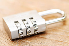Combination padlock close up with chrome numbers on wooden backg. Round Stock Images