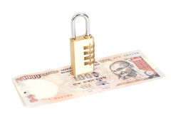 Combination padlock on Indian currency rupee Royalty Free Stock Photos