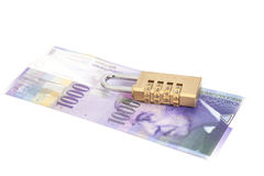 Combination padlock on Swiss francs Royalty Free Stock Photos