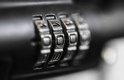 Combination padlock in a wooden door royalty free stock photo