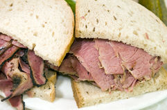 Combination pastrami corned beef on rye sandwich Royalty Free Stock Photos