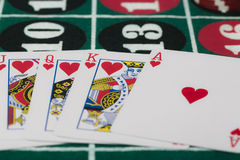 The combination of playing cards on casino table Royalty Free Stock Image