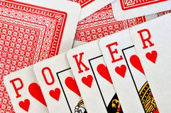 The combination of playing cards. The combination of the playing cards made up the word poker Royalty Free Stock Images
