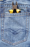 Combination pliers in jeans pocket Stock Images