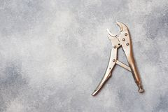 Combination pliers. Tools for cutting solid materials and multiwire cables. Professional ergonomic tools.  royalty free stock image