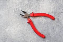 Combination pliers. Tools for cutting solid materials and multiwire cables. Professional ergonomic tools.  stock photo