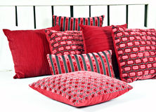 Combination of red and brown pillows Royalty Free Stock Images