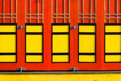 The color of chinese house window. Combination of red and yellow on chinese house architecture style in ketandan village of yogyakarta stock photo