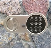 Combination lock on the background of a stone wall stock images