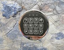 Combination lock on the background of a stone wall stock image