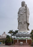 Combination shot of Amitabha statue with Buddha in background. Royalty Free Stock Photo