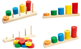 Combination of wooden colored logical toy. On white Royalty Free Stock Photo