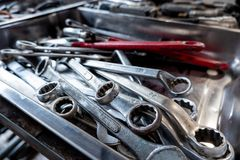 Combination wrenches, spanner, diverse wrench tools in garage.  stock photo