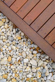 Combinations of timber decking and rocks Stock Image