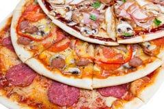 Combinato con tre fette di pizze differenti fotografia stock