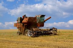 The combine. An image that conatins combine and beautifull cloudy sky stock photo