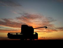 Combine. Silhouette of combine over sunset Stock Photo