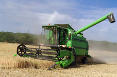 Combine on the field. A combine harvester working a wheat field Stock Image
