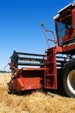 Combine on field. Combine harvester closeup on field under blue sky Stock Photos