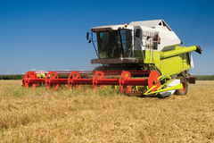 Combine in the field during grain cleaning Stock Photo
