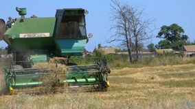 Combine in the field stock video footage