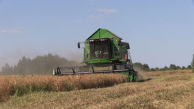 Combine harvest pea plant. SIRVINTOS, LITHUANIA - August 3, 2014: Agriculture combine machine harvest ripe dry pea plants in farm field on August 3, 2014 in stock video