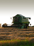 Combine Harvester. A green and yellow combine harvester in action on a field Royalty Free Stock Photography
