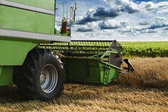 Combine harvester in action on wheat field. Royalty Free Stock Photo