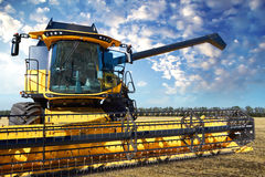 Combine harvester on the background of a stormy sky Royalty Free Stock Photos