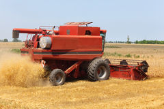 Combine harvester on blue sky. Agricultural machine Royalty Free Stock Image