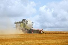 Combine harvester on blue sky Royalty Free Stock Photography