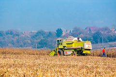 Combine harvester in the corn field. Shyroke, Ukraine - NOV 11, 2015: broken combine harvester in the corn field near the village. combine operator went Stock Photography
