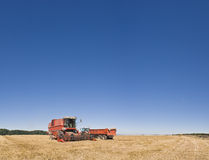 Combine harvester and farmland Royalty Free Stock Photo