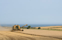 Combine Harvester In Field Royalty Free Stock Photos