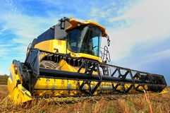 Combine  harvester in the field Stock Photos