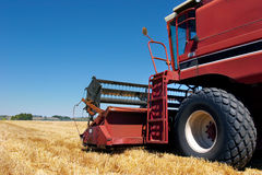 Combine harvester on field. Combine harvester side view close up on field Royalty Free Stock Photo