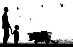 Combine-harvester on field. Man with a boy watching to work of combine-harvester Stock Photo