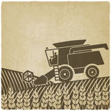 Combine harvester in field old background. Vector illustration. eps 10 Stock Image