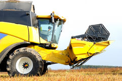Combine harvester during field work on farm Stock Images