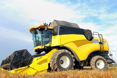 Combine harvester during field work on farm Stock Photo