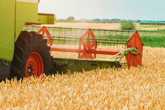 Combine harvester machine harvesting ripe wheat crops Stock Image