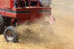Combine harvester in motion. Combine harvester in action. Agricultural scene Royalty Free Stock Photos