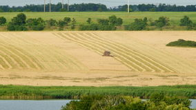 Combine harvester plowing a field Royalty Free Stock Photo