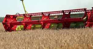 Combine Harvester. Reaper. Agment. Combine Harvester Close Up. Detail Of Grain Harvester Finishing Up Soybean Harvest stock footage