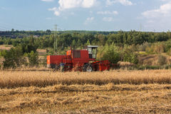 Combine harvester. Red harvester on the field Stock Photography