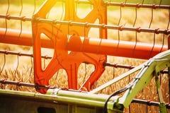 Combine harvester revolving reel harvesting wheat crops Royalty Free Stock Photo